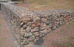 gabion wall with random bricks placed amongst the gabion rock fill http://www.gabion1.com.au