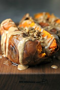 Getting tired of the same old breakfast routine?  Mix it up with a Breakfast Sweet Potato stuffed with granola and almond butter!
