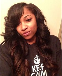 glamourous layered wavy curly sew in hairstyle