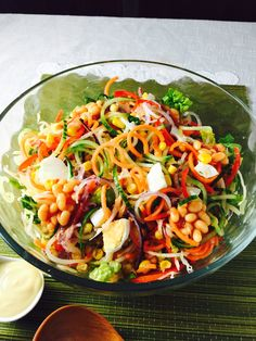 Spiralized salad, with sliced boiled egg, baked beans, and sweet corn in it. Yum Yum.