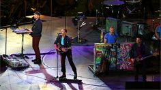 (L-R) Will Champion, Chris Martin, Jonny Buckland and Guy Berryman of Coldplay perform during the Closing Ceremony.