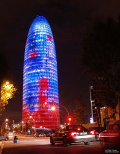 Torre Agbar - Barcelona, Spain;  designed by Jean Nouvel from B720 Arquitectos, 2005;  the facade is a double skin with a maintenance gateway between the inner and outer skins – the inner portion is painted sheet metal, and the outer portion is formed by lame glass fixed in steel structures anchored to the concrete walls of the building;  the tower has more than 4,500 LED lights that light up at night