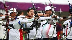 Juan Rene Serrano (C) of Mexico in action during the Archery men's individual ranking round at Lord's Cricket Ground on 27 July 2012. London Olympics 2012