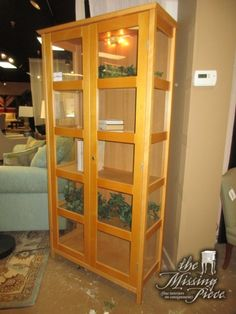 """Transitional style curio cabinet in a light finish with glass front and sides. There are four shelves inside. It is lit as well. Beautiful piece! Could go in almost any room. 36""""wide x 15""""deep x 71""""high.  Arrived: Monday January 2nd, 2017"""