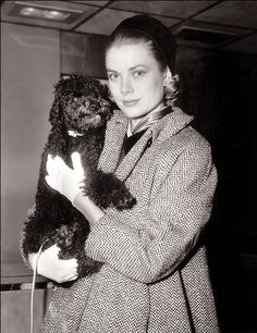 Grace Kelly and her poodle, Oliver, a gift from Cary Grant during the filming of To Catch a Thief.