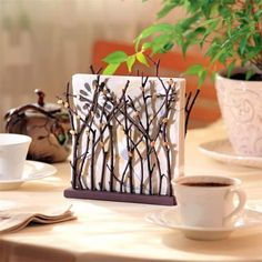 Adorable DIY Napkin Holder. Could easily paint to match your decor.