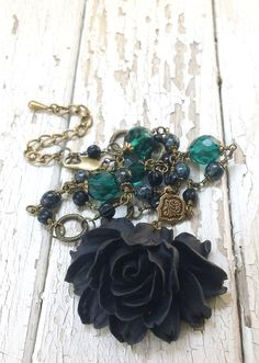 I n s i d i o u s. ...Black Lotus flower pendant necklace - Find all your Fall Wardrobe Accessories at EternalAutumn! $40.00