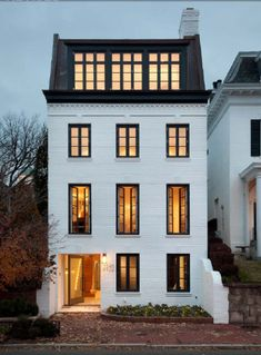 white painted brick - black frame windows