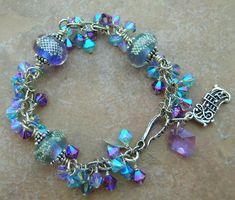 Love how this glows!  ~Musical Bling!~   Handmade Gold Fumed Lampwork, Swarovski Crystal & Sterling Silver Bracelet by 5 Fish Designs