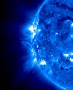 Loops and arcs shoot from two active regions on the sun, April 8, 2013. The STEREO's (Ahead) spacecraft took the image in extreme UV light. The loops consist of plasma at temperatures up to a million degrees C., arcing along the lines of magnetic fields.