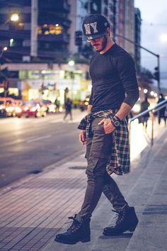 Great look- skinny cargo pants, plaid top, and cap!!
