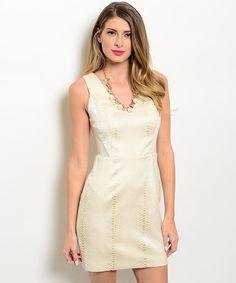 https://www.porporacr.com/producto/vestido-beige-textura-escamas-inmediata/