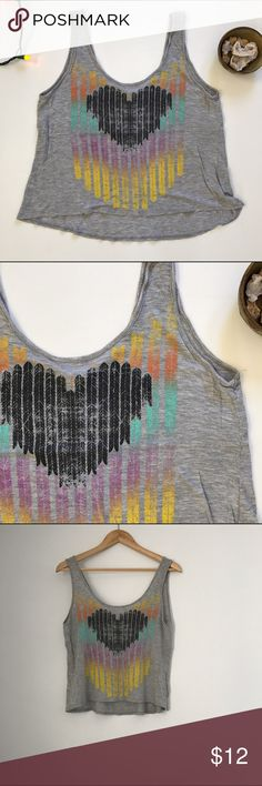 Grey crop tank top with graphic rainbow heart This is a great little lightweight tank top, perfect to wear with skinnies, moccasins, and a chunky cardi in cooler weather. You could also style it with cutoffs and French braids for a concert! I think this top would even make a good yoga top... there are so many possibilities for this piece. ❤️ This top is gently used and in great condition, and is size medium. Delia's Tops Crop Tops
