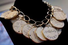 Elizabeth Taylor's gold and ivory necklace featuring ivory opera passes from the 18th and 19th centuries, a gift from the estate of Edith Head. (Interesting piece and great history having belonged to Edith Head and Liz Taylor - Wow)