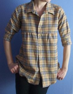 Turn a men's shirt into a tunic. Pull up the sleeves, make a gathered front, keep all original collars, cuffs, and buttons. This one's a Burberry shirt. by rene