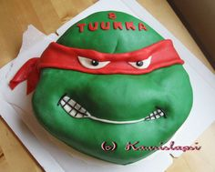 Turtles (TMNT) cake - This cake is for a 8 years old boy who loves turtles. Because I have a girl, I have no idea about these boys things. The birthdayboy liked it anyway.  Cake is filled with strawberries, whipped cream and strawberry jam. On top of it there is a buttercream under a marzipan.