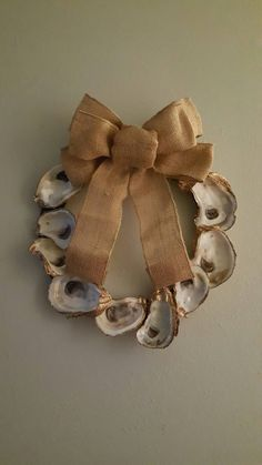 Lovingly gilded oysters adorn this 12 inch wreath. Adorned with a removable burlap bow and ready to hang. Please allow weeks to ship plus shipping time. Other sizes are available by request. Seashell Wreath, Seashell Ornaments, Seashell Art, Seashell Crafts, Beach Crafts, Oyster Shell Crafts, Oyster Shells, Decor Crafts, Diy And Crafts