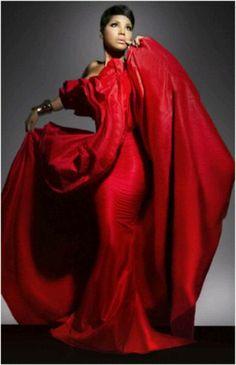 Singer Toni Braxton wearing a beautiful red dress.