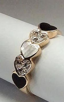 10K gold ring with 2 black heart shaped onyx, 6 diamonds and one heart shaped mother of pearl.