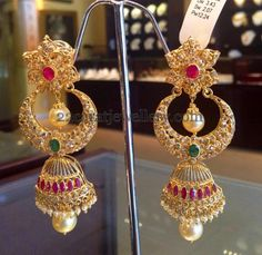 These earrings are really pretty, a little bit different from the norm. They would work really well for an indian/pakistani bride Jewellery Designs: Huge Chandbali Designed Jhumkas Gold Jhumka Earrings, Gold Earrings Designs, Gold Diamond Earrings, Coral Earrings, Diamond Jhumkas, Jhumka Designs, Peacock Earrings, Indian Earrings, Indian Jewellery Design