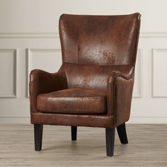 Brown leather accent chair with black feet for your living room, bedroom, or home office. Wingback Chair, Armchair, Chair Cushions, Chair Pads, Upholstered Chairs, Chair Fabric, Swivel Barrel Chair, Front Rooms, Living Room Seating
