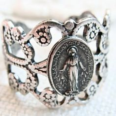 Antique miraculous medal ring. i really want one! i cant stand wearing things around my neck so this would be perfect! gosh such a good idea!