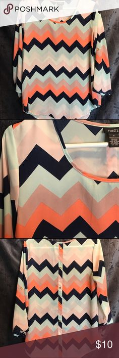 Chevron Top Rue 21 chevron top. Flowy material with buttons on the back. Looks great with dress pants or jeans. Rue 21 Tops Tunics