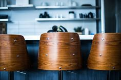 The Detail Looks of Adjustable Kitchen Bar Stools with Reclaimed Wood Back Support from Industrial Condo Loft by LUX Design