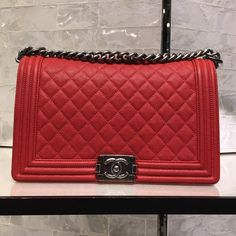 "Authentic Chanel Boy Bag in New Medium Brand new in box 100% Authentic Chanel Boy Flap Bag New Medium in red with brushed hardware from the Spring 2016 Collection. Purchased this year (2016) and comes with everything you would get at the Chanel store; box, dust bag, authenticity card and receipt. Size: 7.5"" x 11"" x 3.5"" Interior zip pocket and open pocket. Retails $5200.00 + tax!! Sold out in stores! CHANEL Bags Shoulder Bags"