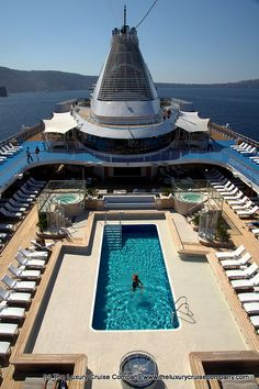 The inviting pool deck on board #Oceania Cruises Marina -  anchored in Santorini. We'll coordinate your destination wedding travels for you! We save you the time, hassles, and frustration of planning! 2744.mtravel.com/ or info@c2ctravels.com #luxurycruise #cruise #travel #luxuryvacation