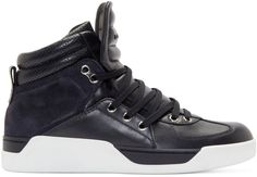 High-top buffed leather sneakers in dark navy blue. Round toe. Silver-tone eyelets at divided, partially-elasticized lace-up closure. Tonal logo accent at ribbed padded bellows tongue. Perforated and ribbed stitched padded collar. Suede panelling at sides and heel. Matte white rubber sole. Tonal stitching.