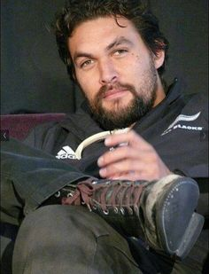 Wearing an All Blacks jacket - Jason Momoa