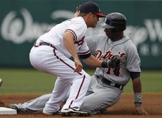Detroit Tigers' Austin Jackson steals second base as Atlanta Braves shortstop Tyler Pastornicky fields the throw in the first inning. (Paul Sancya / Associated Press)