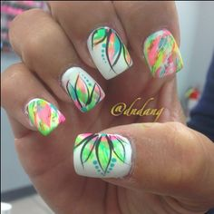 Multicolor Neon Nails With Flower Accents and Turquoise Dots.
