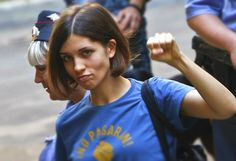 Nadezhda Tolokonnikova, the 22 year old member of the performance art group Pussy Riot raises her fist in Solidarity with her supporters.  Photo credit:  Reuters