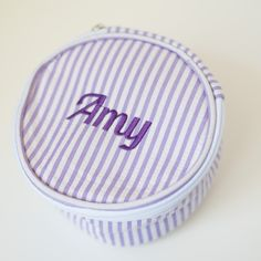 These generously sized 6 inch wide by 3 inch tall seersucker rounds with zip closure are intended for jewelry but our customers have found them useful for earphones, phone chargers, makeup and more. Embroidered with Name or 3 Letter monogram.
