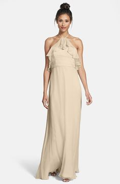A styling idea for a wedding showing neutral and champagne bridesmaid dresses with accessories.