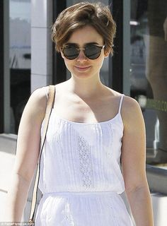 Cute: Lily's choppy pixie cut looked good with her tortoiseshell wayfarers...