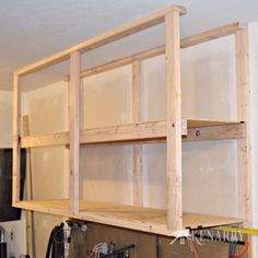 how to create garage storage with ceiling mounted shelves