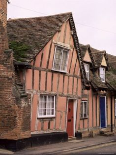 Pink Tudor period timbered House in Lavenham, Suffolk, England  There was a crooked house on a crooked little street, it went a crooked mile.: