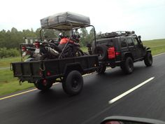 JKU pulling a M101 trailer with 2 motorcycles and a roof top tent
