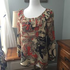 Leifsdottir Anthropologie Patterned Silk Top In like new condition, I've only worn a couple of times. Beautiful, light top. Has ruffle detail on front, side zipper. Size 6. No trades or Paypal. I love offers, but please don't lowball me. Anthropologie Tops Blouses