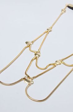 The Draped Dome Necklace in Antique Gold with Leather Neck Strep by Elizabeth Knight