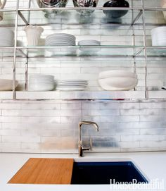 Kitchen: shiny, silver back splash -handmade Davlin tile in white goldleaf from  Ann Sacks