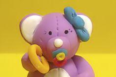 Das Baby-Bärchen ist ein handgefertigtes Einzelstück.     Die Augen sind aufgemalt.     Die Figur ist komplett aus Polymer Clay eigens von Hand gefert