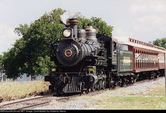 """Grapevine Vintage Railroad #2248, a 4-6-0 """"Atlantic"""" type locomotive constructed by the Cooke Locomotive Works in 1896.  Originally numbered Southern Pacific 1829, it was renumbered 2248 in 1901.  Assigned to fire train service, it was leased to the Pacific Fruit Express from 1945-1949.  Retired in 1961, it was sold for scrap but luckily saved, being sold to other railroads before a rebuild in 2001.  In 2004, it was sold to the Grapevine Vintage Railroad, where it is lovingly known as…"""