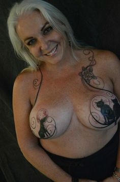 Beautiful tattoo and definitely support the women that tattoo their breasts after such horrific experience. Bringing beauty and sexiness back.