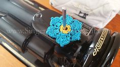 A charming little decorative to add to the top of your Singer Featherweight 221 or 222K or any Sewing Machine for that matter. Instead of the red felt, use one of these handmade spool pin doilies to p