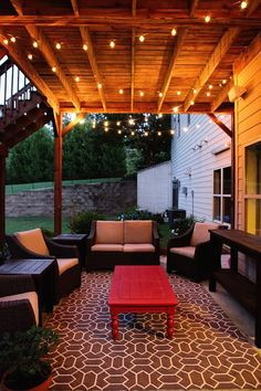 Idea for under deck outdoor patio at new house outdoor rugs put together to make big rug and Christmas lights)--gorgeous feeling. I could do this on my patio Patio Under Decks, Back Patio, Backyard Patio, Diy Patio, Small Patio, Garden Gazebo, Diy Porch, Outside Living, Outdoor Living