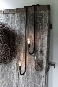 The candle holder can be hung on a cupboard or an old door. This is the big candle holder in the photo. Wabi Sabi, Small Candle Holders, Big Candles, Old Doors, Chandelier, Modern Rustic, Candle Sconces, Rustic Decor, Lights